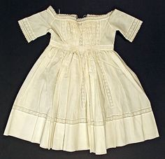 Dress, 1863. Probably American. Looks like cotton with some lace and embroidery. Metropolitan Museum of Art.