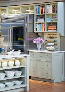 Love the bookshelves and rolling pins.  The perfect baker's kitchen