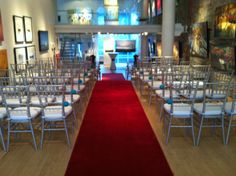 Red carpet entrance at this intimate gallery ceremony
