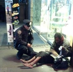 """On  Nov 14 it was freezing. Officer Larry DePrimo saw this homeless man with no shoes and asked him if he had any shoes. The homeless man touched his heart with his kind words """"I've never had a pair of shoes but God bless you, thank you for doing what you are doing. Officer DePrimo went and bought him some socks and shoes not realizing his picture was being taken. This truly is a great act of kindness."""