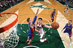 Ersan Ilyasova #7 of the Milwaukee Bucks goes to the basket against the Detroit Pistons on November 25, 2014 at the BMO Harris Bradley Center in Milwaukee, Wisconsin. Photo by Gary Dineen/NBAE via Getty Images