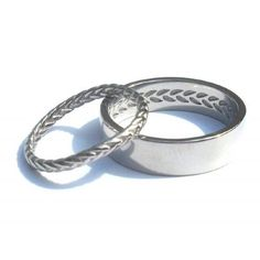 These White gold wedding rings were created to reflect a strong connection with one another. The delicate wreath patterned ring was designed and moulded to sit with a vintage heirloom engagement ring. Whilst the male wedding ring had a contemporary designed profile yet held internally the negative of her ring - a hidden treasure - how romantic! #bilingual #wedding #jewellery