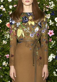 This is a Gucci embroidered brown dress  Looks real cute.