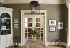 brown grasscloth in entryway - design indulgence: BEFORE AND AFTER OF THE FOYER