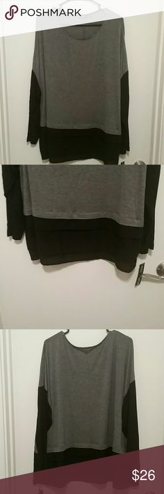 Long sleve top Grey and black long sleve blouse. Size 2X. Brand new with tag. Main color is grey with partial black sleves as well as a black sheer 3 layer ruffle on the bottom. Great top very comfortable and versatile. Apt. 9 Tops Blouses