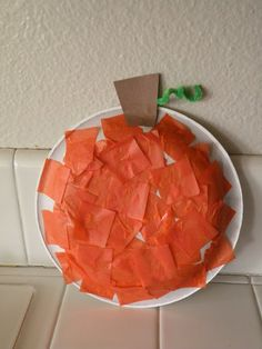 SwellChel: SwellChel Does Halloween: Pumpkin crafts for kids  VERDICT - Yep, cute!  Yurned out great and kept the kiddos occupied (ages 2, 5, & 7) for a bit!!  I let them tear construction paper to use to draw it out a little longer....