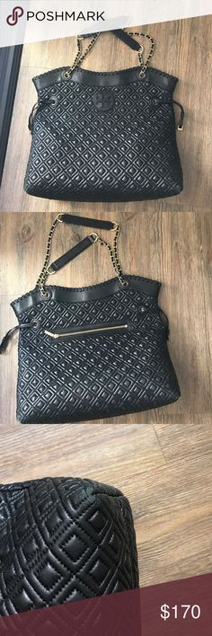 Large Quilted Tory Burch handbag Black leather oversized Tory Burch quitted handbag. The finishing is gold medal. Purse is large enough to carry just about anything so it's great for traveling. Has some wear showing in the corners. I bought this retail for 695. Tory Burch Bags Shoulder Bags