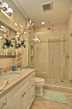 nicely remodeled small bathroom...there wouldn't be a huge vase with flowers...and there'd be more color