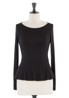 Look perfectly prim in a peplum top. The Pep Rally Tee in Black from KOKOON Boutique Without Borders $69