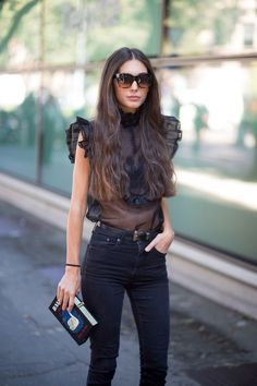 A sheer black top and skinny black jeans are perfect on Diletta Bonaiuti. - HarpersBAZAAR.com