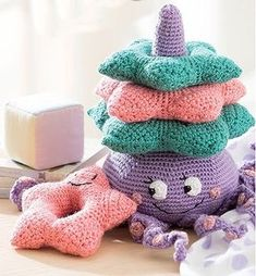 Make A Stuffed Toy Baby Stacks - 6 Easy Toys to Crochet - Colorful yarns and embroidery floss details combine to create these delightful stacking toys. Baby Stacks from Leisure Arts presents 6 easy crochet designs using medium weight Crochet Baby Toys, Crochet Toys Patterns, Amigurumi Patterns, Stuffed Toys Patterns, Baby Blanket Crochet, Crochet Designs, Crochet Gratis, Crochet Amigurumi, Crochet Dolls