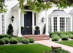 I find white houses with black front doors and herringbone pattern brick porches/walkways quite charming & classic! I find white houses with black front doors and herringbone pattern brick porches/walkways quite charming & classic! Black Front Doors, Painted Front Doors, Exterior Paint, Exterior Design, Black Exterior, Garage Exterior, Garage Doors, Garage Entry, Door Entryway