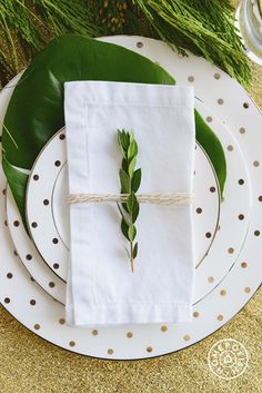 Holiday DIY: twine and a sprig of any kind of plant tied around an ironed napkin.