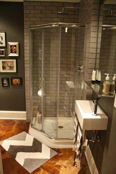 Basement bathroom.  Small sink.  Love the grey tile