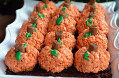 Rice Krispie Pumpkins. Make regular rice krispies and add red and yellow food coloring for orange. Form into balls, add a tootsie roll for a stem and pipe green icing on for leaves.
