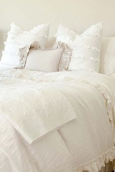 Beautiful white bed.  Linens by Matteo.