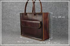 **DETAILS** The bag has a large pocket with magnetic button clasps on the front side. The main compartment closes with a zipper and has a phone pocket inside. Additionally, you can order a detachable strap for this bag. Material: 100% genuine, high quality vintage style leather Size: •