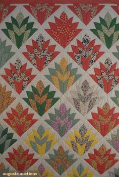 Cotton floral pieced quilt, 1930s  Simply lovely. I have never seen this pattern before.