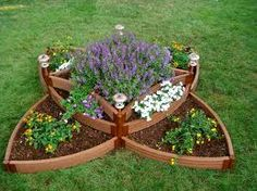 A little raised garden for a few herbs or vegetables. This one's pretty! #PinMyDreamBackyard