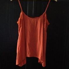 "Camisole Burnt sienna/orange Cami top by Free People/Intimately. Lace detail along edging and under arms. Adjustable straps. Lace dips down in ""U"" shape in back and splits open. Free People Tops Camisoles"