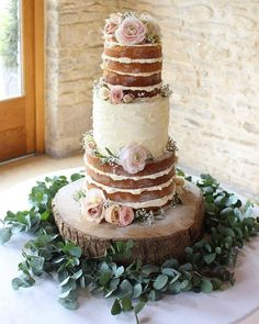 Beautiful naked wedding cake and butter cream wedding cake topped with eucalyptus garland and flowers for the cake. #weddingcake #nakedweddingcake #love #wedding #cake #eucalyptus #roses