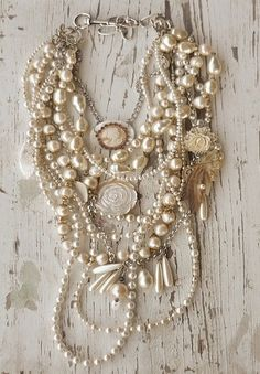 pearlsark:  Inspiration: The beautiful strands of pearls and small ornaments in this necklace. Romantic!