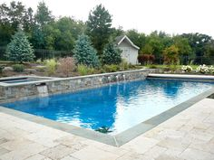 We mix a variety of materials to give your design it's own unique character and style.  Here, we've incorporated a combination of Natural Vintage Travertine Paver Stone for the patio, Full Range Thermal Blue Stone to line the pool's edge, and an American Granite Vaneer Wall  to encase four Waterfalls.