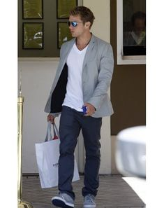 Gray sportcoat takes a very simple ensemble to another level. Gray blazer, blue pants, white v-neck t-shirt, gray shoes.