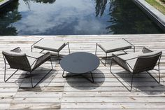 Table basse / contemporaine / de jardin / ronde - SERAC by Mark Gabbertas - OASIQ