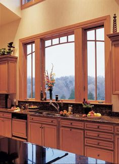A stunning example of a beautiful, wood Picture Window flanked by two Casements with very unique grill work. A head-turner for any kitchen!