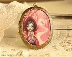 Once upon a time there was a girl called little Red Riding Hood..  original cameo locket with perfume. fairy tale jewelry by KarolinFelix. €145.00, via Etsy.