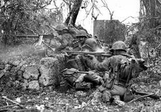 Marines lay down suppressing fire on a Japanese position.   Peleliu Island September, 1944.