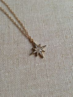 Delicate Gold Starburst Charm on 16 inch Gold Chain on Etsy, $60.00