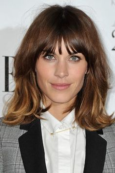 15 Long Bobs We Love - Alexa Chung with ombre highlights, bangs, and a length that goes just beyond her shoulders.