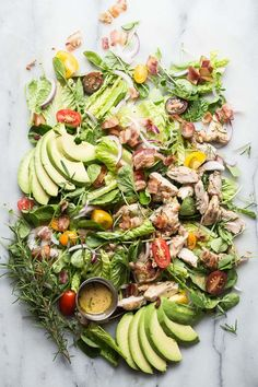 A fresh and vibrant chicken salad falloff tomatoes, red onion, avocado and rosemary chicken. Drizzled with a rosemary Dijon dressing and perfect for summer.