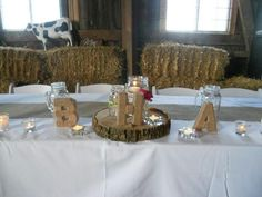 Head table for a rustic barn wedding ...with custom made centerpieces...burlap, twine & ribbon decorated mason jars with floating candles & twine wrapped block letters in the bride & groom's initials...CANDLES everywhere!! ;) Kill's Custom Creations