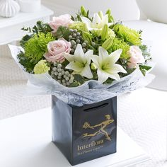 We love the green chrysanthemums in this winter chic hand-tied.