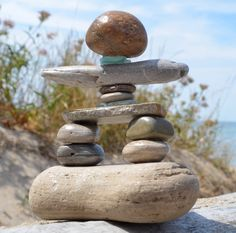 Inukshuk: the likeness of a human - the shape of a man Im a wee bit addicted to building inukshuks & Cairns when Im out beachcombing. Every lovingly built Inukshuk that gets glued together like this one, is made from items gathered by me while beachcombing either the shores of Lake Huron or Lake Ontario. This particular gem is made from beach stones, and hand gathered beach glass. These mini monuments are similar to those that have been used by the Inuit for communication and survival to…