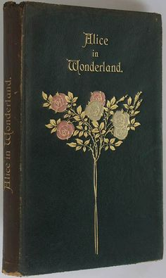 Vintage Book cover Alice in Wonderland. There are various covers for this story; this one has a delicate illustration with gold, red and white roses. Quite antique looking.
