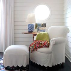 I love everything about this. Would be so cute in a baby girl's room. Love the small round window.