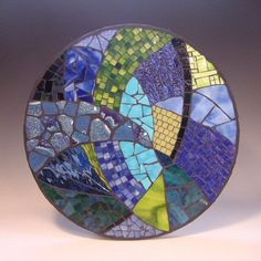 "Splash Mandala   2004     15"" diameter   stained glass, vitreous tile, tinted mirror and pottery on MDF.        Currently Unavailable                                                                                                                                                                                 More"