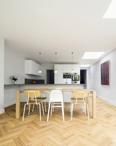 Within this victorian terrace in South East London, the existing reception rooms to the front of the house have become connected to a new combined living/dining/kitchen area to the rear, with the resultant circulating spaces also functioning as independent storage, activity and study areas. The new side and rear extension provides a well proportioned space for family life. Natural daylight and sunlight is obtained through new rooflights positioned to illuminate the various zones.