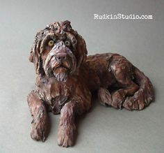 Dog sculpture in honor of a wise and wonderful doodle.