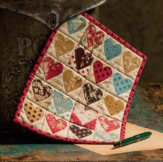 Make this sweet mini quilt for someone you love - quick! This adorable quilt comes together so fast with fusible applique, you can make it in multiples.