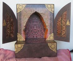 Oriental Shrine. I decorated this shrine with colour photocopies of rugs and paper doilies sprayed with gold.