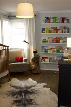 Crib colour? floor? Rug, wall colour. Would swap out that chair and table, change the shelves, etc