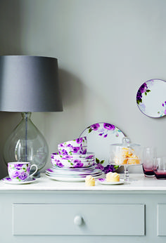 Oversized blooms in opulent shades bring a romantic, feminine look to homewares.