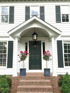 Front Door Style (Spring Edition), colonial house, knockout rose topiaries, black and white, lantern pendant, black door