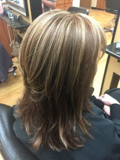 Dana used Redken Color Gels to enhance her client's natural red hair. She then added a few foils for dimension!  Hair by Dana