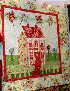 I LOVE quilts with Houses on them.  Getting ready to make one myself. This one is really cute too.